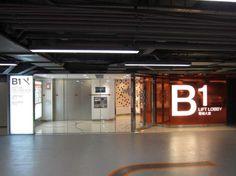 WTC More (Hong Kong) Distinctive Lift Lobby design. Pleasant sense of arrival. Park Signage, Wayfinding Signage, Parking Design, Signage Design, My Building, Building Design, Elevator Lobby Design, Cinema Architecture, Tv Wall Decor