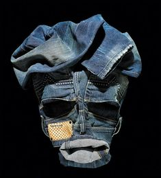 Creative cloth Faces by Bela Borsodi | Spicytec--Let the clothes be folded with creativity.