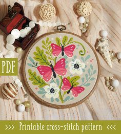 Butterfly Flowers Cross Stitch Pattern This pattern is an instant download PDF. Size: 115w x 112h stitches 14 Count Aida: approx.8.21 x 8.00 inches or 20.86 x 20.32 cm Stitches Required: Full cross stitches Colors Required: 9 DMC floss colors PDF Included: - Pattern in color symbols