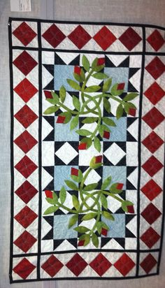 Stained glass window pieced and hand applique