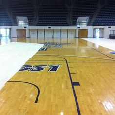 Prepping the court in Moody Coliseum for new paint! Click to see a mock-up of the finished project.