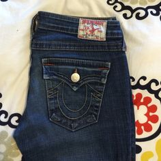PRICE ⬇️ True Religion Joey Bootcut Jeans Awesome Joey style True Religion jeans. Low cut, flare bottom, asymetrical seam down legs (picture 3). Some wear at heal side of led opening (picture 4), none on front side. Great jeans!!! True Religion Jeans Boot Cut