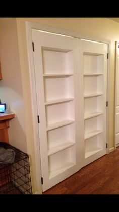 Bookcase doors!  Perfect for rarely used doors you really want to put a bookshelf in front of. Double Inset Bookshelf Doors | Do It Yourself Home Projects from Ana White