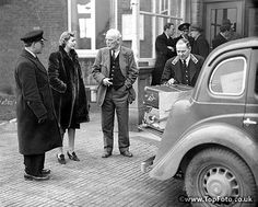 Lord Redesdale and his daughter Miss Deborah Mitford discussing the packing of the luggage at Folkestone, before Miss Deborah Mitford started out for High Wycombe with her sister's (Unity Mitford) luggage.  22nd October 1935