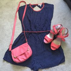 NEW Polka dot romper Never worn. Adorable romper. Navy blue with white polka dots. With salmon/coral colored accents on neckline and belt. A large but could definitely fit a medium because from Delia's and their clothes run small. Other