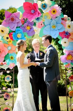 Paper flowers as decorations at this Colorful Wedding with Sweet DIY Details! on http://pizzazzerie.com @Courtney Baker Whitmore | Pizzazzerie.com