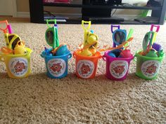 Beach theme finding Nemo birthday favors. Stickers by paperpinkmonkey on eBay.  pals w/ shovels & other items from oriental trading company