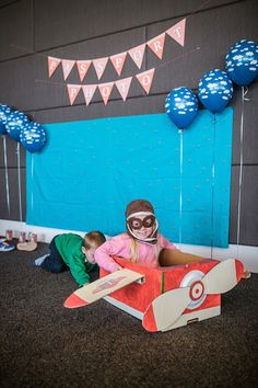Photo Booth from an Airplane in the Clouds Aviator Birthday Party via Kara's Party Ideas KarasPartyIdeas.com (5)