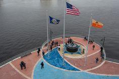 "Southbank Riverwalk, Flagpoles, Naval Memorial Statue, ""A New Look for the Southbank Riverwalk"" via EU Jacksonville"