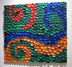 Bottle cap art. Very neat. This is all plastic soda bottle caps.
