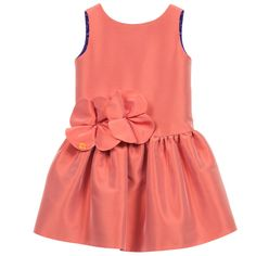 Girls beautiful, muted orange taffeta dress by ValMax with a pretty purple lining that can subtly be seen. It has a cross over 'V' back with large flowers on the front of the waistline with a drop waist and full skirt.<br /> <ul> <li>50% silk, 40% viscose, 10% polyester (taffeta)</li> <li>Lining: 100% viscose (smooth & silky)</li> <li>Hand wash</li> </ul>