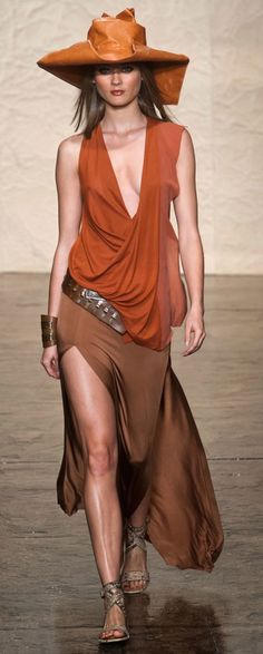 If I was a runway model, this would be my style, love the colours, the hat, this outfit rocks!!!  Donna Karan