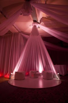 Prop Studios themed a large conference for Estee Laude. Two large rooms were draped with white polyester giving a contemporary look. The walls were then lit with pink strip lights. Props also created two tipi pods with drapes cascading from the ceiling to form a cone shape chill-out area, each pod was filled with bean bags and clear Perspex box tables, lit in the same style as the rest of the room. The effect was finished with pink flamingos!