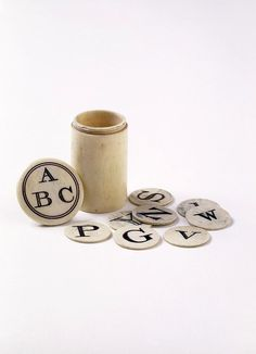 Blocks:bone counters engraved with capital letters one side and small letters on the other