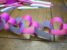 I made some of these Heart chains for Valentines this year (19mth old daughter at home). she was so excited when she woke up to see the simple decorations set up. It was great!