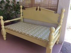 Bed-frame bench. Made this bench by recycling a twin size bed frame.  Used outdoor fabric to create the cushion.