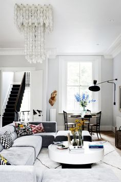 Small dining space in corner of living room with large chandelier