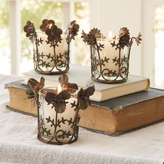 """SHADOW FLOWER VOTIVES, SET OF 3--Handmade, each with its own flower design, these candle votives cast a shadow play of petals. Recycled steel/brass solder/glass. Imported. Catalog exclusive. Set of 3. 3-5/8"""" dia. x 3""""H."""