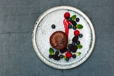 Chocolate soufflés - Bitter-sweet chocolate paired with fruity summer berries.