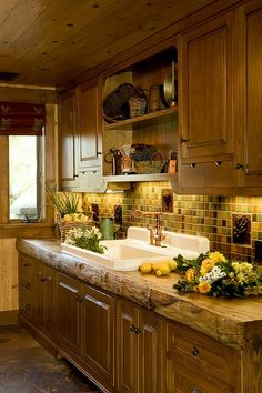 Alder cabinetry and California Sycamore countertop with Coastal Live Oak inlaid butterflies