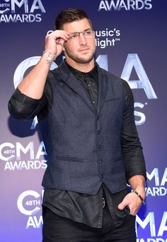 Tim Tebow Photos: 48th Annual CMA Awards - Press Room
