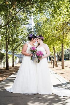 Cute wedding photo idea - brides pose with matching bouquets and floral crowns {Gawne Designs Photography}