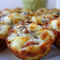 Pepperoni & Sausage Pizza Puffs:  ¾cup flour ¾tsp baking powder ½tsp garlic powder ¾cup milk 1egg lightly beaten 1cup shredded mozzarella 2oz mini pepperoni (about ½ cup) 4oz sausage (cooked & crumbled) Pizza sauce for dipping