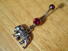 belly button piercing, not that I really want one but this is super cute!  Belly Button ring Elephant with dark pink Gem by ChelseaJewels