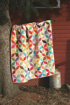 A quilt isn't just a blanket. It's bits and pieces of history, little scraps of life (for better or worse) caught in a colorful pattern.