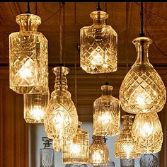 great way to showcase crystal decanters. turn into pendant lights with a chandelier feeling!
