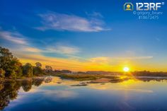 Beautiful lake at sunrise brought to you by Ryhor Bruyeu. Download now before it expires! #123rf #free