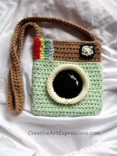 Creative Art Expressions Hand Crocheted Instagram Purse is 8 inches wide x 8 1/2 inches tall. This was a special order and one of my first crocheted items to make without a pattern!