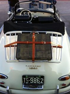 porsche with a satchel on the rack...looks like the perfect setting to start a roadtrip!