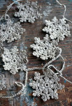 Crochet Garland - Wall Hanging - Small Doily Bunting — Snowflake garland — 10 motifs —- natural linen by namolio US. Crochet Diy, Crochet Garland, Crochet Motifs, Crochet Snowflakes, Crochet Crafts, Yarn Crafts, Crochet Projects, Crochet Patterns, Diy Crafts