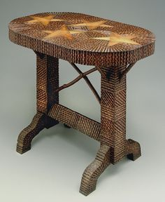 """Folk art table, rounded rectanglar wormy chestnut top with four inlaid stars, squared legs and arched feet, inlaid geometric forms with chip carved applied elements, probably original surface, base with pencil inscription """"From Father 5-17-35 in his 81st year"""""""