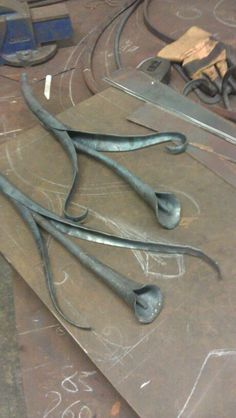 Forged lilies by Tom Fell - Blacksmith