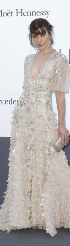 RED CARPET CANNES 2013 - Milla Jovovich wearing Valentino Couture at the amfAR's 20th Annual Cinema Against AIDS event held during the Cannes Film Festival.