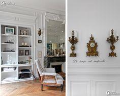 Un placard du salon se transforme en cabinet de curiosités, une horloge et ses chandeliers s'accrochent sur un mur