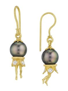 Anthony Lent Tahitian pearl earrings in gold with diamonds.