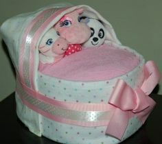 Bundle of Joy Bakery Diaper Cake Bassinet.  Adorable and Practical.  Contains over 25 brand name diapers as well as receiving blanket, burp cloth, toy for baby and washcloths.  Perfect shower gift or centerpiece.