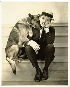 antique photo of man and german shepherd--love the sweet expression on the dog's face. @KaufmannsPuppy