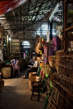 Yangon, BURMA - Reading in the market by Steven McCurry