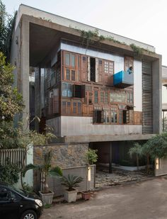 Reclaimed windows and doors form facades of Collage House by SPS Architects