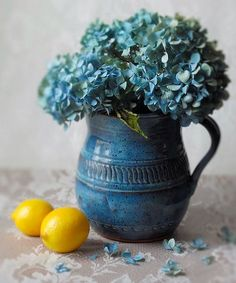 Blue pitcher with flowers & lemons