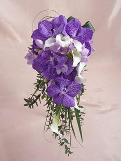 Vanda Orchid Bouquet    A beautiful cascade style bouquet with beautiful Vanda orchids, calla lilies, freesias, guelder rose and seasonal foliage.