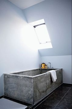 This amazing Concrete Bathtub makes a real statement. The rawness of the concrete compared to the modern decor makes the tub the main emphasis of the bathroom.