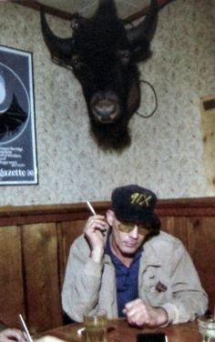 Hunter S. Thompson. Looks to be at the Woody Creek bar outside of Aspen. It was his favorite local hang out.