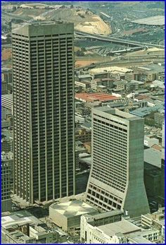 South Africa's first skyscraper, The Carlton Centre in Johannesburg at 50 stories high. The Carlton Hotel is alongside. Very hip place to hang out in its day! Johannesburg City, Carlton Hotel, Out Of Africa, Famous Places, African History, Brutalist, Africa Travel, Architecture, Live