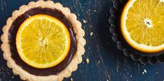 These tarts mix the heavenly taste of rich dark chocolate and orange for a melt-in-the-mouth dessert. Chocolate And Orange Tart, Chocolate Tarts, Wine Recipes, Lime, Fruit, Desserts, Food, Chocolate Pies, Tailgate Desserts