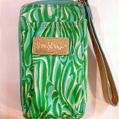 Lilly Pulitzer Green Phone Holder Wristlet Bag Green and blue wristlet bag. Features zipper closure, clear slot for quick ID access on outside, multiple interior slots for holding credit cards+phone! Good used condition! Lilly Pulitzer Bags Clutches & Wristlets